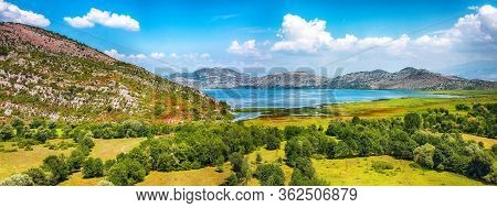 Awesome View Of Skadar Lake Surrounded By Green Mountain Peaks On A Sunny Day. Location: National Pa