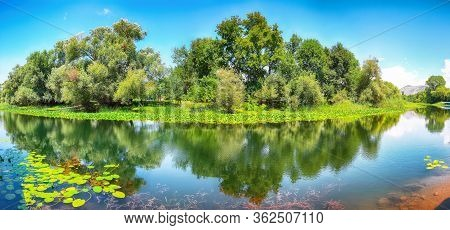 Sunny Morning View Of Valley Of Moraca River. Skadar Lake Tour. Location:  Skadar Lake National Park