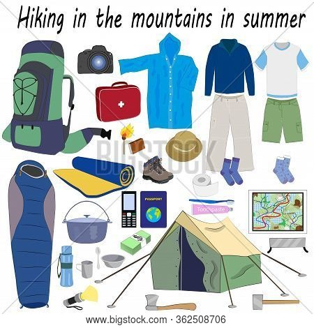 A Set Of Necessary Things For A Trip To The Mountains In Summer: A Tent, A Sleeping Bag, A Raincoat,