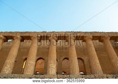 Valley of the Temples (Valle dei Templi), an ancient Greek Temple built in the 5th century BC, Agrigento, Sicily. Famous tourist attraction in Italy. Old marble columns of the Doric order.