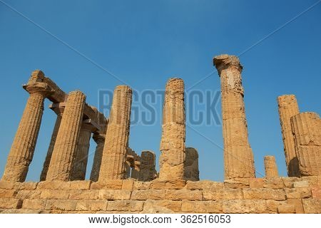 Valley of the Temples (Valle dei Templi), ancient Greek Temple built in 5th century BC, Agrigento, Sicily. Famous tourist attraction in Italy. Old marble columns of the Doric order. Travel destination