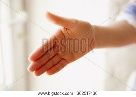 Close Up View Of Caucasian Female Hand Greeting Somebody, Copyspace. Communication, Agreement, Contr