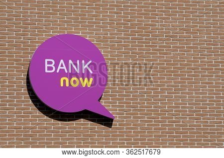 Manno, Ticino, Switzerland - 14th April 2020 : Logo Of The Swiss Bank Now Company Hanging On A Brick