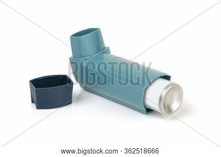 Asthma Inhaler On A White Background With Light Reflection