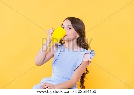 Not My Cup Of Tea. Making Sip. Drink Enough Water. Girl Kid Hold Mug Yellow Background. Lovely Child