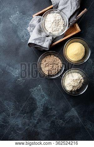 Various Vegetable Gluten Free Flour Corn,sesame,oat,coconut In Glass Bowl On Dark Gray Background.al