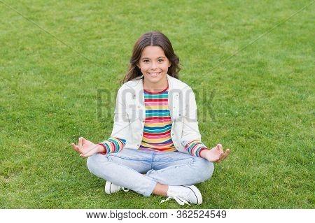 Peace Of Mind. School Break For Rest. Adorable Pupil. Girl Kid Sit On Lawn. Girl School Uniform Enjo