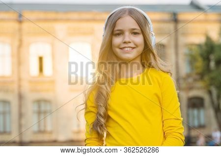 Delivering Audio To Your Ears. Happy Girl Listen To Music Outdoors. Little Child Wear Audio Headphon
