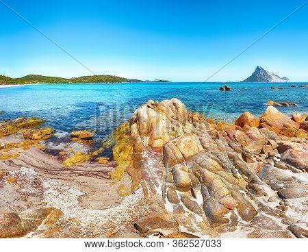 Fantastic Azure Water With Rocks Near Beach Porto Taverna. Location: Loiri Porto San Paolo, Olbia Te