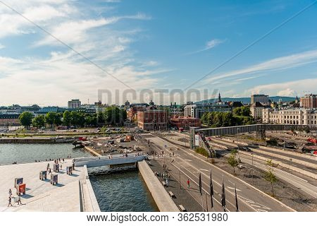 July 26, 2013. Day View Of The Opera House And Promenade In Oslo, Norway. Tourists Enjoy The View Of