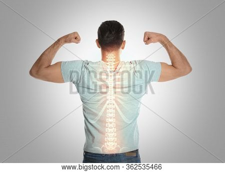 Man With Healthy Back On Light Background. Spine Pain Prevention