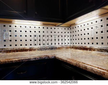 Add on under cabinet lighting in kitchen. countertop lights
