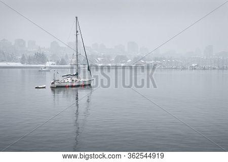 False Creek Sailboat And Snow. Winter Snow Over False Creek, Vancouver.