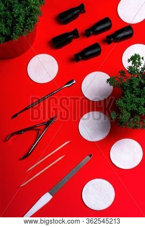 Equipment For Manicure And Pedicure On A Orangebackground. Tongs, Nail File, Pusher, Cotton Pads. Ho