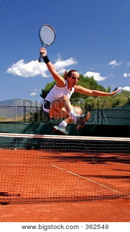 Girl Jumping Tennis Net