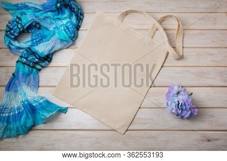 Tote Bag Mockup With Blue Scarf And Flower