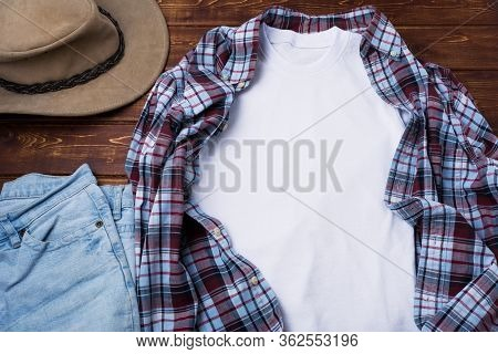 Men's T-shirt Mockup With Plaid Shirt And Hat.