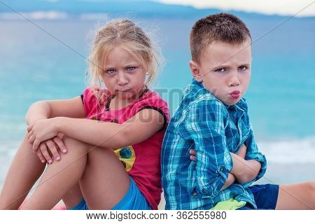 Upset Siblings Boy And Girl Sulking Sitting With Arms Crossed Back To Back, Not Talking, Kids Brothe