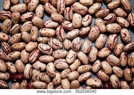 Haricot beans on a stone table.