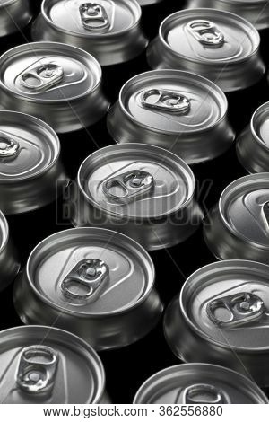 Many unopened beer cans seen from above closeup full frame