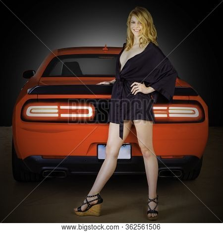 Pretty Blond Woman Wearing A Robe With An Orange Muscle Car Hot Rod.