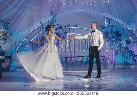 Wedding Ceremony In An Outdoor Banquet Hall Decorated With Huge Blue Flowers. The Bride And Groom Ho