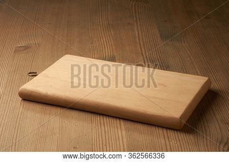 Close-Up Of Wooden Cutting Board On Table