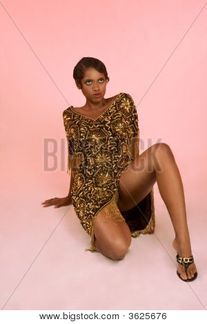 Sensual Ethic Woman In Caftan Sitting On Floor