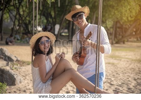 Happy Young Honeymoon Couple On Beach Having Vacation Fun At Paradise Tropical Island Beach On Sunny