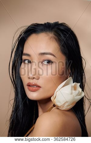 Fresh, Natural Skin. Attractive Sensual Woman With Tan Skin, Holding Dried Lotus Buds Isolated On Be