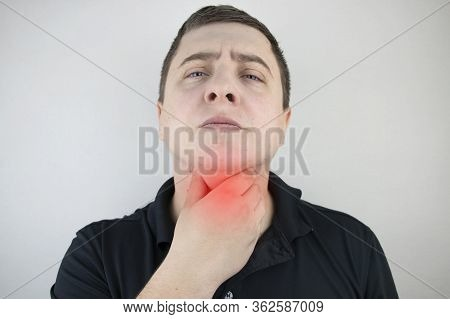 A Man Touches A Sore Throat And Neck, Twists From Irritation And Inflammation. Sore Throat When Swal