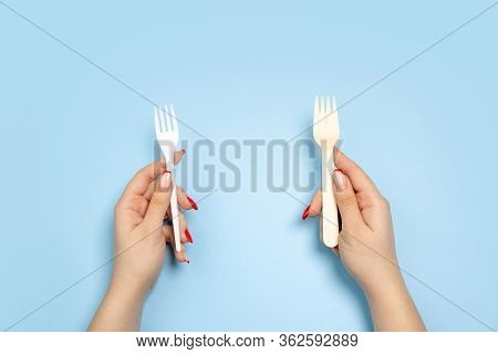 Forks. Eco-friendly Life - Organic Made Recycle Things In Compare With Polymers, Plastics Analogues.