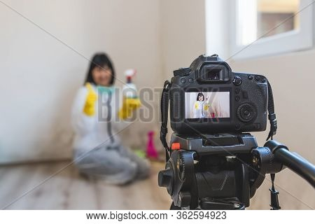 Video Camera Filming Woman Cleaning Mold From Wall Using Spray Bottle And Showing Gestures Thumbs Up