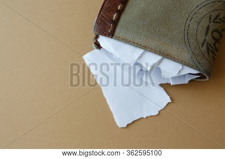Empty Wallet With Pieces Of Paper Instead Of Money On A Light Monophonic Background, Top View. Bankr