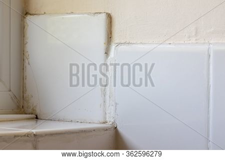 Bad Tiling Diy Disaster. Rogue Trader Or Do-it-yourself Fail. Ceramic Bathroom Tiles Badly Fixed And