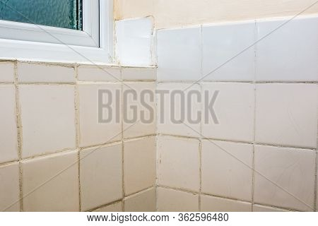 Bad Tiling. Terrible Bathroom Tile Diy Fixing And Grouting Job. Old White Ceramic Tiles With Untidy