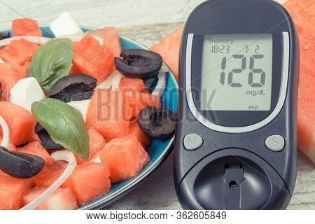 Glucometer With Result Of Sugar Level And Fresh Prepared Summer Salad Of Watermelon And Feta Cheese.