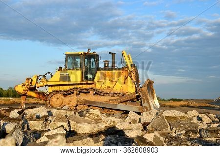 Bulldozer At Construction Site. Heavy Equipment For Digging, Demolition, Construction And Ground Wor