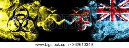 Quarantine In Fiji. Coronavirus Covid-19 Lockdown. Smoky Mystic Flag Of Fiji With Biohazard Symbolp