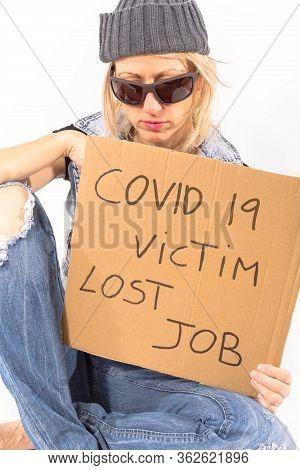 Coronavirus Pandemic And Job Loss. Homeless Woman, Victim Of Covid-19 Crisis, Begging For Money With