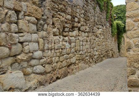 Stone Cobbled Footpath Of The Medieval Village Of Pals, Located In The Middle Of The Emporda Region