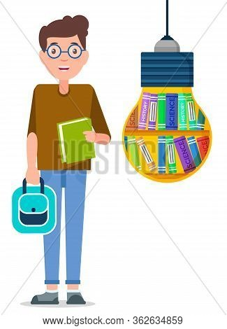 Young Boy With Backpack And Copybook In Hands Ready For Studying. Student Stand Near Big Light Bulb