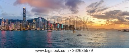Panorama View Of Cityscape And Skyline At Victoria Harbour At Sunset Time. Popular View Point Of Hon