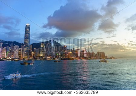 Cityscape And Skyline At Victoria Harbour At Sunset Time. Popular View Point Of Hong Kong City At Tw