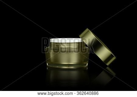 Mockup Empty Luxury Golden Cream Jar For Skincare And Beauty Skin Is Uncover, Isolated On Black Back