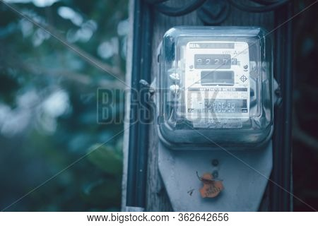 Samut Prakan, Thailand - April 21 2020 : Electric Power Meter On Electric Pole In The Front Of House