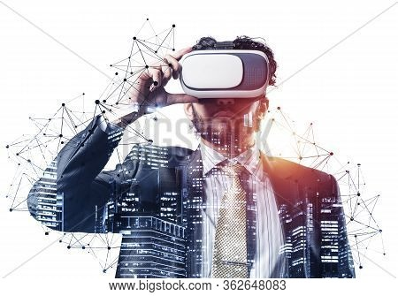 Handsome Young Man Standing With Vr Headset. Businessman Wearing Vr Goggles And Exploring Virtual Re