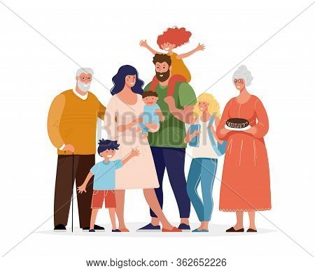 A Large Happy Family Is Standing And Hugging. Several Generations, Grandparents, Parents With Childr