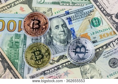 Symbol Coins Of Bitcoin On Banknotes Of Us Dollars. Exchange Bitcoin Cash For A Dollar. Golden Bitco