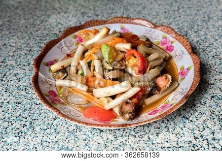 Thai Papaya Salad With Lotus Leaf. Papaya Salad Or What We Called In Thai Som Tum With Lotus Stem Is